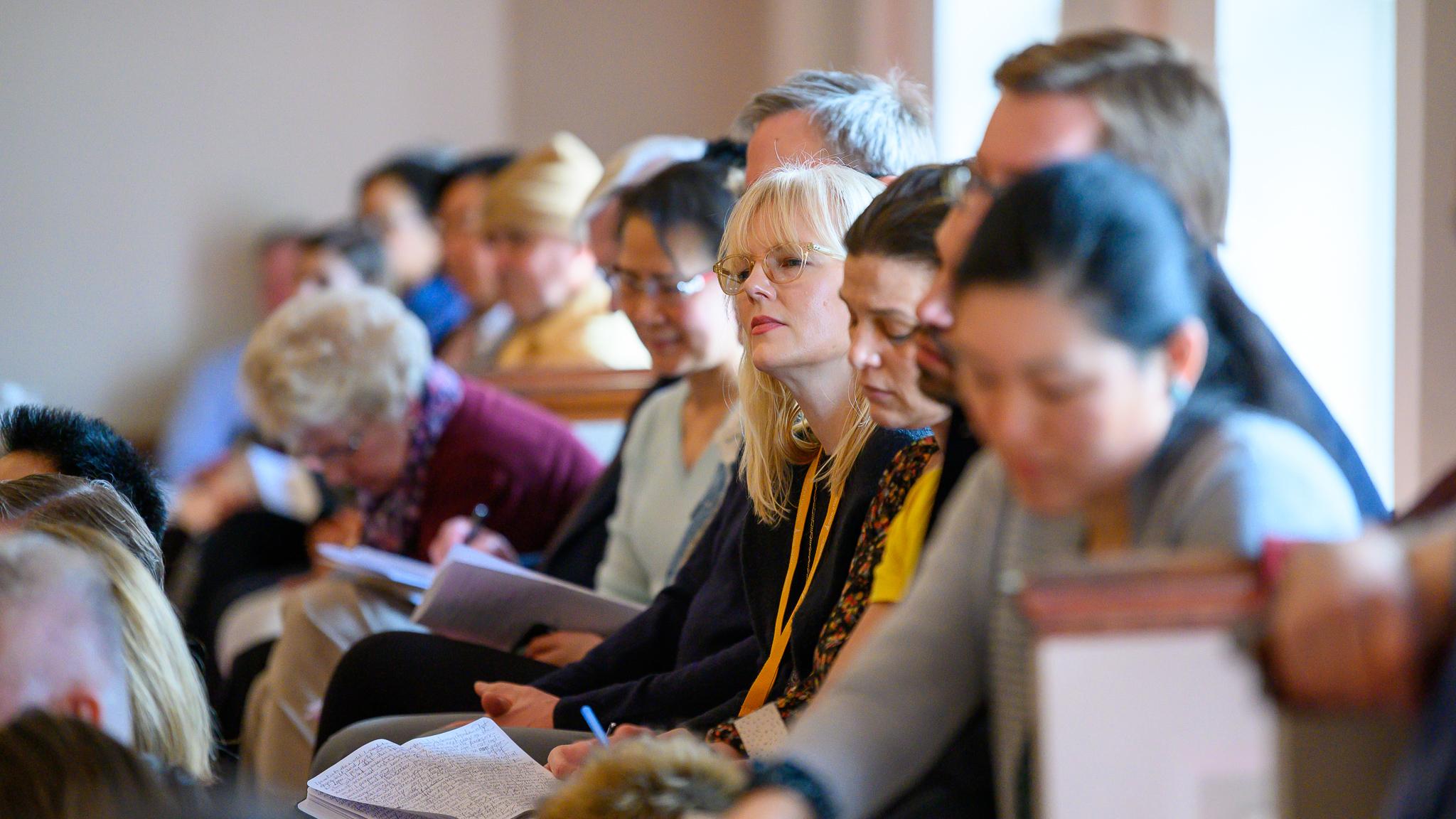 Congregants listening to a sermon